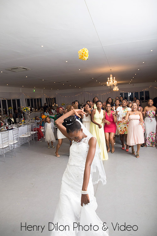 Bride throwing her flowers at a wedding